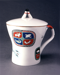 Cylindrical, flaring outward towards top, loop handle, lid with finial in shape of inverted V. Painted with brightly colored stylized arctic animals and geometric motifs.
