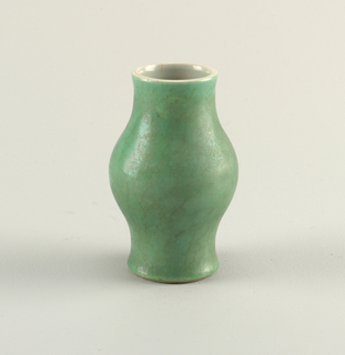 Bulbous, with contracted base and neck. Green outer glaze somewhat crackled, and with pale iridescence. Kang Hsi.