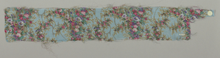 Sample of sheer pale blue-colored silk with a multicolored print of four vertical columns formed by solidly massed small-scale flowers. Over this, a design of scrolling lines, circles and irregular lozenges brocaded in metallic gold thread. Both selvedges present.