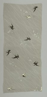 Plain gray silk crepe with swallows in black and shades of gray. Over the plain gray ground are strewn fine white lines and occasional groups of colored dots that look like falling flower petals.