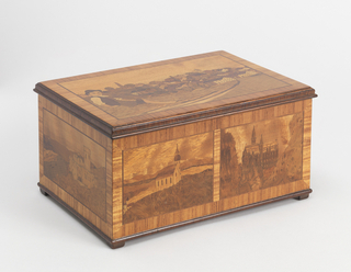 "Rectangular box, lid hinged at back; cover and each face decorated with scenes of rural village life or a building within landscape, all depicted in various inlaid woods. Interior of lid with inlaid and stained wood decoration showing couple boating on a lake with forrest and a couple of buildings in the background. Floor of box inlaid with "" E R"" over ""1934"" whithin decorative lozenge."