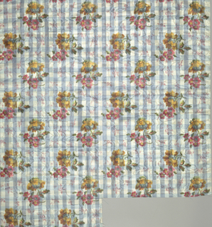 Ground of blue and white woven gingham plaid moiré has a chiné printed allover pattern of yellow and red flower clusters. Both selvedges present.