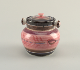 Tall jar with bulbous body and straight mouth, two knobs as handles on each side, lid with flat finial. Decorated in reds and browns, some floral element on body with blues horizontal stripes across.
