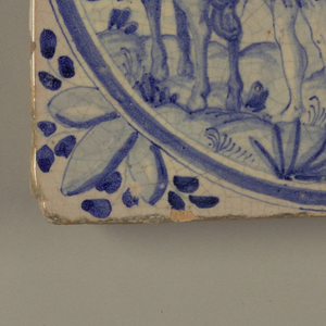 """Group of four tiles, square, with blue underglaze decoration on buff ground, each with name of one of the four continents, and corresponding allegory and attributes within a circular medallion: -72a, """"Asia,"""" showing turbaned figure riding in a howdah on back of an elephant, with two attendants; birds in foreground, turreted architecture in background; -72b, """"Europa,"""" showing a lady, cavalier and dog in foreground, watching woman in a sedan chair carried by two men; European style buildings in background; -72c, """"Africa"""" with a turbaned man and woman, with attendant holding parasol, with the attributes of monkey, ostrich and camel; -72d, """"America"""" showing an Indian in feather skirt and headdress, carried on a litter by five similarly but less ornately dressed Indians, and attended by one holding a fan; at left a conquistador on horseback, and a cockatoo on a branch; in right background, a sailing ship."""
