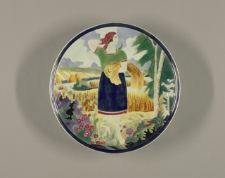 Large, circular, with image of woman holding sheaf of wheat and sickle, standing at edge of wheat fields, birch trees right, flowers left. Glazes predominantly green, yellow, red, separated by cloisonne-like ridges.