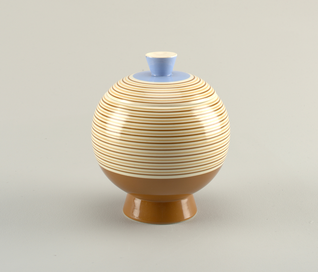 Spherical vessel with tapering foot and tapering knob. Striped glaze at center, blue and white glaze at knob and orange-brown glaze at bottom.