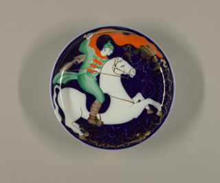 Circular, with raised edge; against a dark blue underglaze background, a Red Army soldier with sword, mounted on white horse; behind them a crowned double-headed eagle.