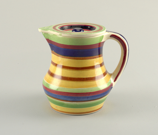 Undulating circular shape with protruding triangular spout at top edge placed opposite c-shaped handle connected at top edge and near the bottom.  Body banded with green, brown, blue, burgundy, and tan.  Handle striped with cream, blue, and burgundy.  Cover is shaped to match the body and is concave in the center with a blue finial and surface concentric circles in green, brown, blue, black, rose, and tan.
