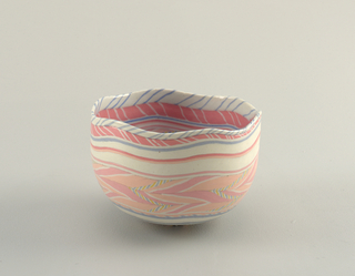 "One porcelain bowl, ""Hexagonal Pink,"" coiled polychrome clay body (Neriage tech.) with exterior unglazed and interior clear glaze; 22 carat gold ornament on interior bottom."