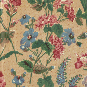 Textile showing a stippled salmon-colored ground with a design of scattered grasses, leaves and flowers in red, brown, lavender, solid green and bright blue. Printed using blocks from between 1830–1850.