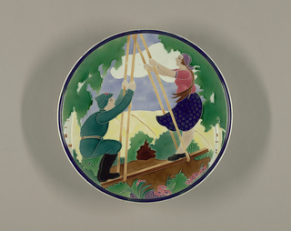 Large, circular, with scene of a peasant girl and young soldier on swing in pastoral setting; glazes predominantly green, yellow, red, separated by cloisonne-like ridges.