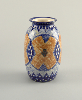 Tall vase with spreading lip. Mottled blue and orange glaze. Painted blue chains divides the surface into circular and diamond compartments. Blue and white triangular pattern at base and neck.