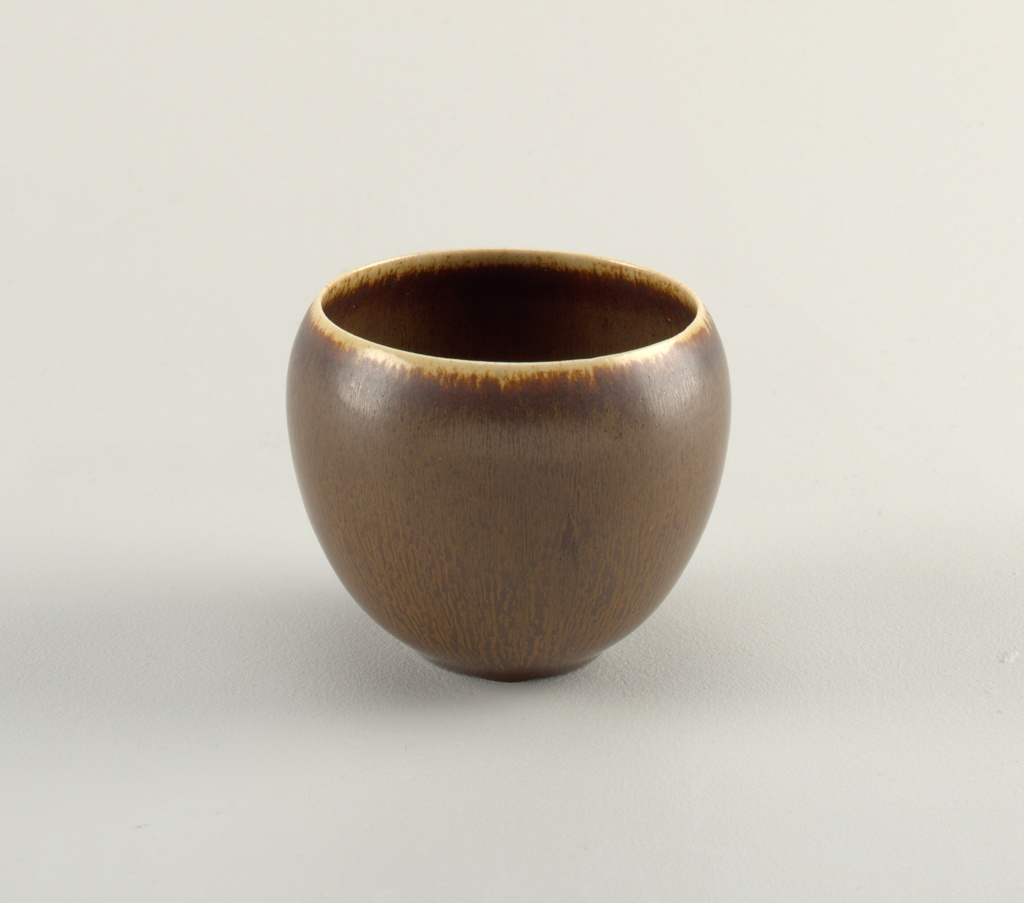 Ovoid vase, sharply tapering in at bottom. Hare's foot glaze (streaked brown, black, and cream); irregular drip banding of cream-colored glaze around mouth.