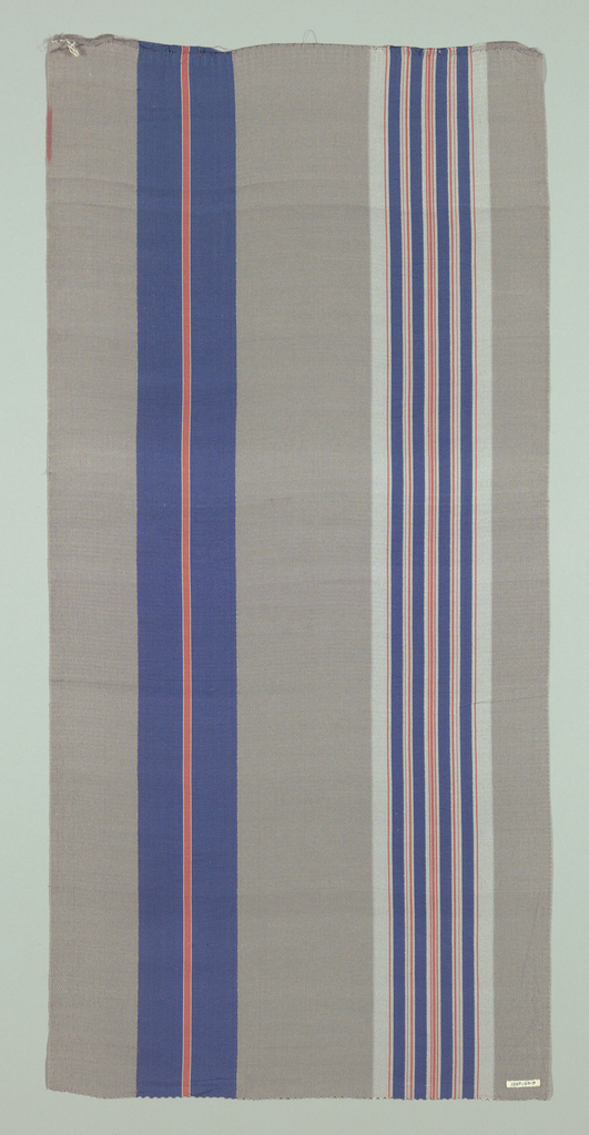 Gray crepe with vertical stripes of blue, red and white.