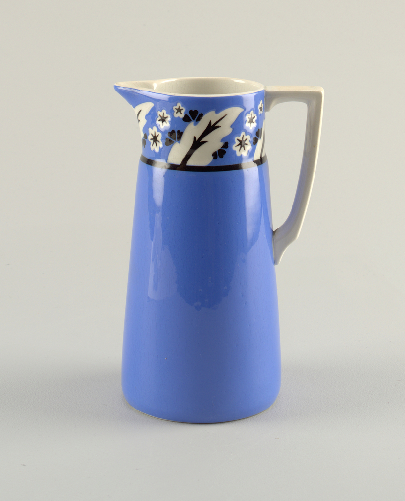 Tall, blue, cylinder body that slightly tapers towards the opening. The top rim is 