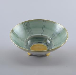 Deep circular  bowl on three semi-circular feet.