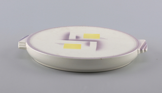 Circular plate with inset bottom rim, grooved top edge, and two tab handles each molded in a double step pattern.  White background with purple lining the edge of the two handles.  Central design of two yellow squares and airbrushed purple lines.
