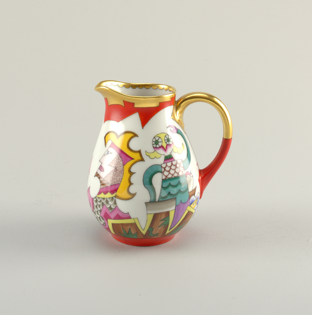 Pitcher with loop handle and rounded body. Gilt rim and handle. Body depicting abstract multicolored figures.