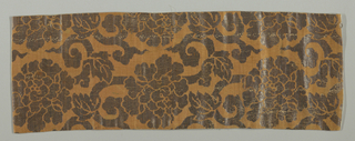 Panel brocaded with silvered paper in a large allover stylized floral pattern. Design is silver against a brown ground.