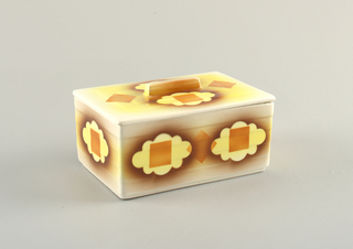 Rectangular box. Flat lid with flight overhanging lip and ling rectangular handle. Atomized and hard edged glaze showing cloud forms overlapping with squares.