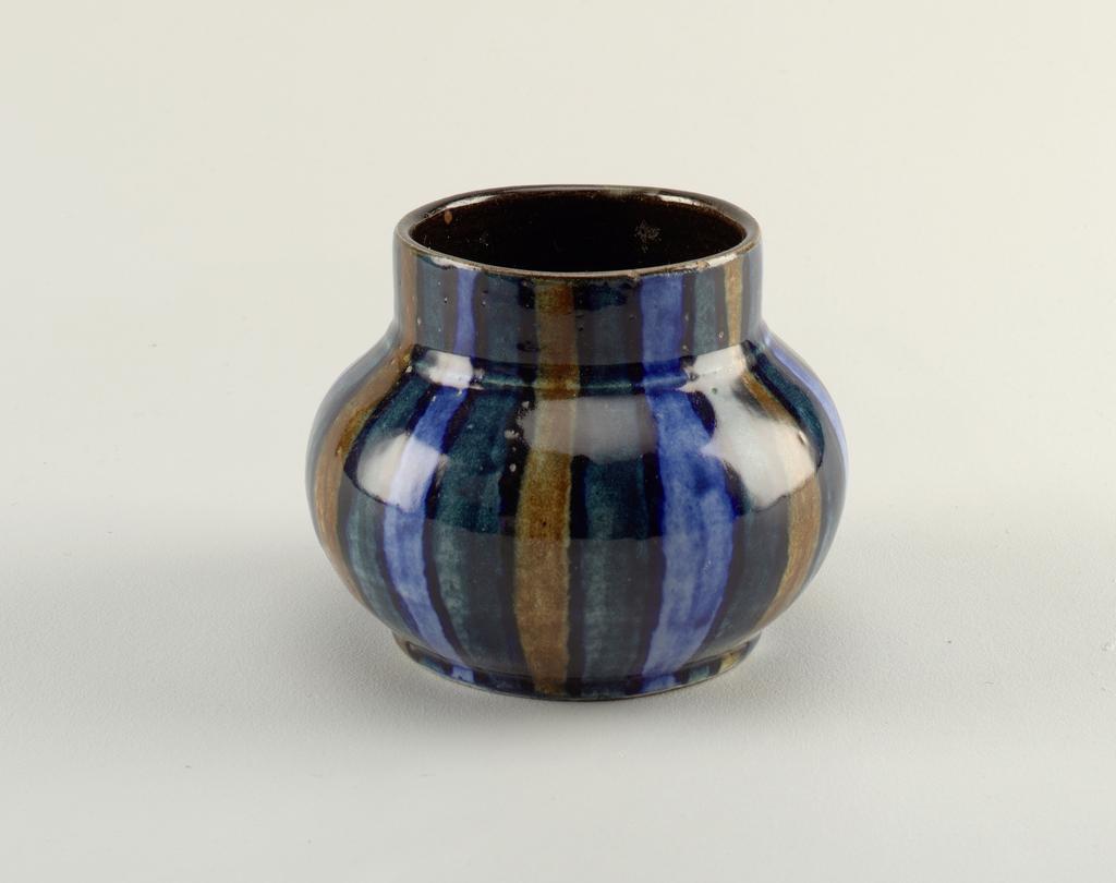Ovoid vase with short, straight neck. Vertical striped glazed.