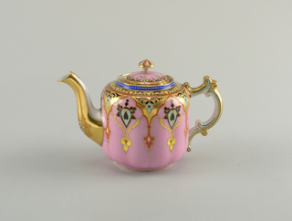 Lobed, straight-sided body; curving spout; tripple c-scroll shaped handle; domed lid with matching lobes and mushroom-shaped finial.  Body enameled with pink; gilt, polychrome arabesques falling from shoulder.