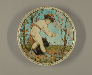 Large circular, concave plate, molded with foot ring. Reverse plain glazed. Obverse painted with continuous foliate border. Within border painted in polychrome underglaze pigments: a nude child and cat within a landscape, with trees and a potted cherry tree in bloom against a blue sky.