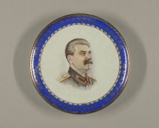 "Circular; painted in the center with a portrait of Joseph Stalin; a blue border edged by gilded leaf bands and with the inscription (in Russian) ""To Joseph Vissarionovich Stalin, The Creator of Great Victories"""