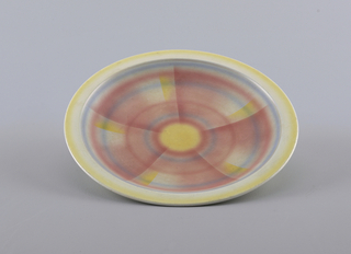 Round with hazy concentric circles in red, yellow and blue.