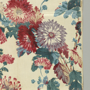Allover design of asters in red, purple, blue and green on an off-white ground.
