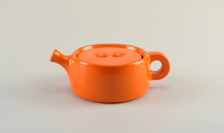 Stacking tea service consisting of (a,b) warmer and metal insert; (c,d) water pot and cover, and (e,f) teapot and cover. All pieces, except (b) are glazed in brilliant orange inside and out. (a) flattened cylindrical shape, flat bottomed, with oval opening at side to insert candle or spirit container. (b) circular galvanized metal insert with four holes to permit heat and air to travel upwards. (c) waterpot of similar cylindrical shape, with flaring spout and thick simple loop handle. (d) cover is flattened, and rests inside lip of pot, and fitted with two hemispherical depressions for fingers. Flaring spout and loop handle matching waterpot. (f) Domed cover with two depressions for fingers.