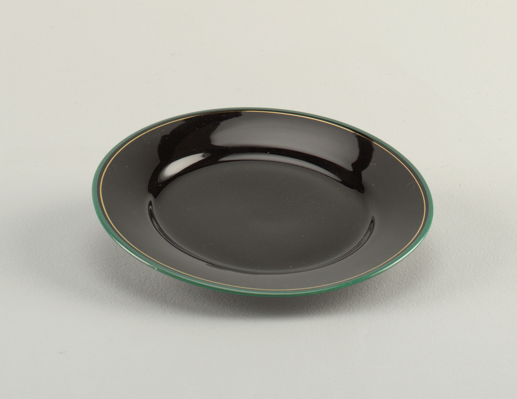 Black plate with edge in turquoise and thin line of gold.