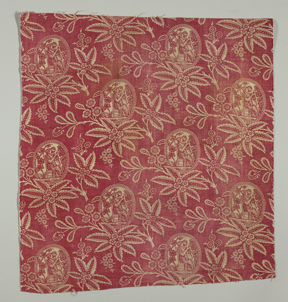 Design in white reserved on red ground fabric. Between floral motifs are medallions with scenes showing a mother and child.