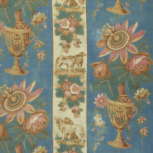 Part of cover or curtain, of cotton striped in blue and white with printed designs in stripes. In blue, a vase with flowers; in white, groups of dogs alternating with flowers. Trimmed with red and white cotton fringe. Two breadths each 29 inches wide.