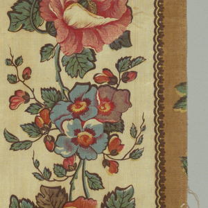 Border with large red and blue flowers with green leaves on a pale yellow ground. Narrow guard borders in tan and dark brown.