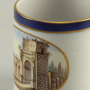Short cylindrical cup (a) with loop handle; gray-white ground decorated with polychrome-painted oval scene showing classical ruin of building wall with arches; thin gilt border around oval; rim with underglaze blue band between two thin gilt lines; three incised concentric lines around base. Circular saucer (b) with gray-white ground decorated with central circular medalion surrounded by thin gilt border, showing classical ruin of wall with columns in landscape; rim with underglaze blue band between two thin gilt bands.