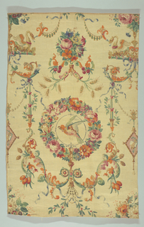 Polychrome block print on beige or natural linen. Symmetrical pattern with classical motifs. Bird, orange and green in circular floral wreath - red, pink, orange, blue, green, surrounded by elaborate classical details. Side motifs of green stalk-forms, with flowing blue ribbons entwined in red and green flowering vine. Stalks are connected to bottom of wreath by elaborate green leafy strapwork, with pine cones, orange fruit and leaves and blue ribbons. Over wreath is a floral cluster with wheat scrolling on the bottom and a canopy of delicate swags, supported by mythical bird-creatures. Condition: soiled