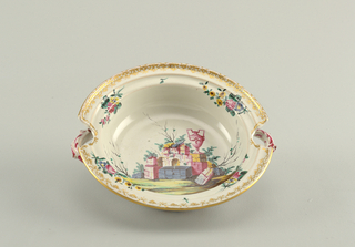 Floral bouquets and gilding at rim. At center, ruins in a landscape. Cut-outs above molded handles.