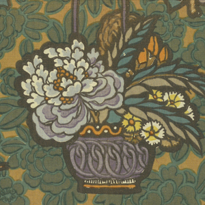 Multicolored block printed fabric has dark yellow ground covered with dense foliage in two shades of green. Scattered over the leaves are blue baskets with blue and yellow flowers, sprigs of blue flowers with butterflies, and dish of fruit and flowers with butterflies. Pattern repeat is one-half drop; fabric matches side to side.