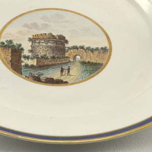 Circular plate of grayish porcelain with blue band between two gilt lines around rim; gilt-bordered circular medallion in center with polychrome ruins of Sepolcro di Cecilia Metella.