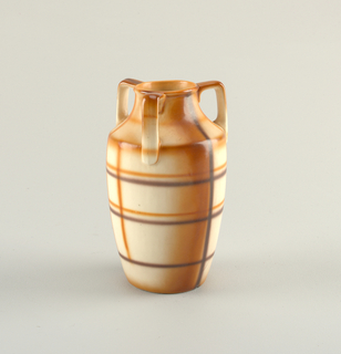 Round cylindrical vase narrow at mouth and widening at ledge on body.  Three protruding handles placed evenly around the top attached at the mouth and the ledge.  Cream background with airbrushed grid design over the entire surface in rust and dark brown.