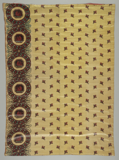 Short curtain or border of yellow cotton with detached conventionalized motif in body of curtain. Border of classic revival design. Enlaced bands form medallions to frame a hippocamp. Color are dark red, black and green (probably blue over yellow). Lined with terra cotta-colored muslin.