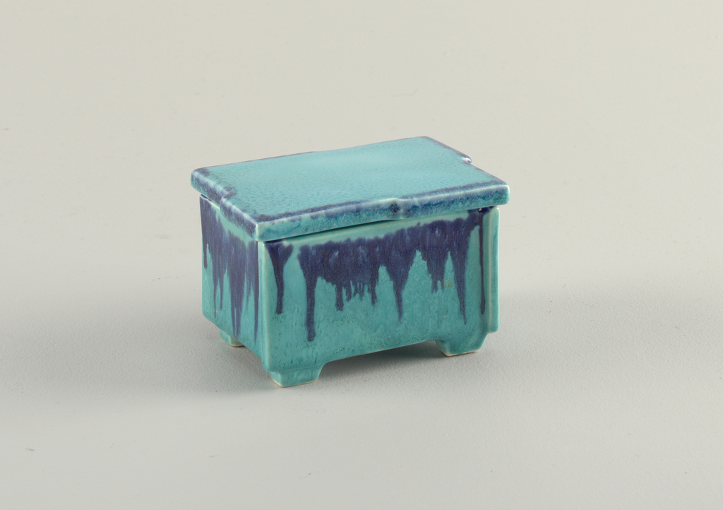 Rectangular box glazed in light blue with dark blue streaks coming down from the top. The lid is flat and also light blue.