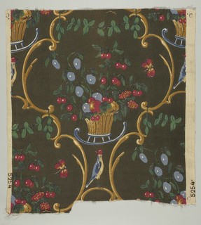 Polychrome block print on black. Formal, symmetrical yellow and tan framed lobed-cartouche form together with yellow basket on blue stand, containing blue and red fruit with green leaves. In bottom of cartouche is bird with red head and blue back. Pattern repeats in half drop; cartouche-form commonly shared by juxtaposed motifs.
