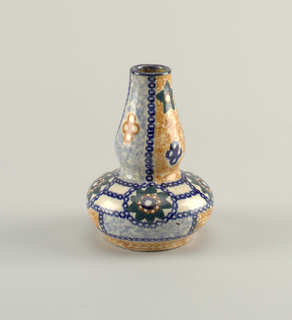 Double gourd form with mottled blue and orange glaze. Painted blue chains divides the surface into compartments. Scattered floral forms.