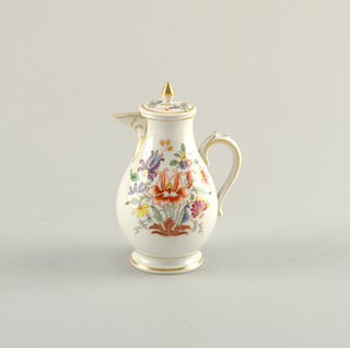 Truncated pear form decorated with multicolor arrangement of stylized flowers and foliage.  With gold line decoration on handle, spout, foot, lid, and finial.
