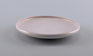 Light lavender dish with inverted lip.