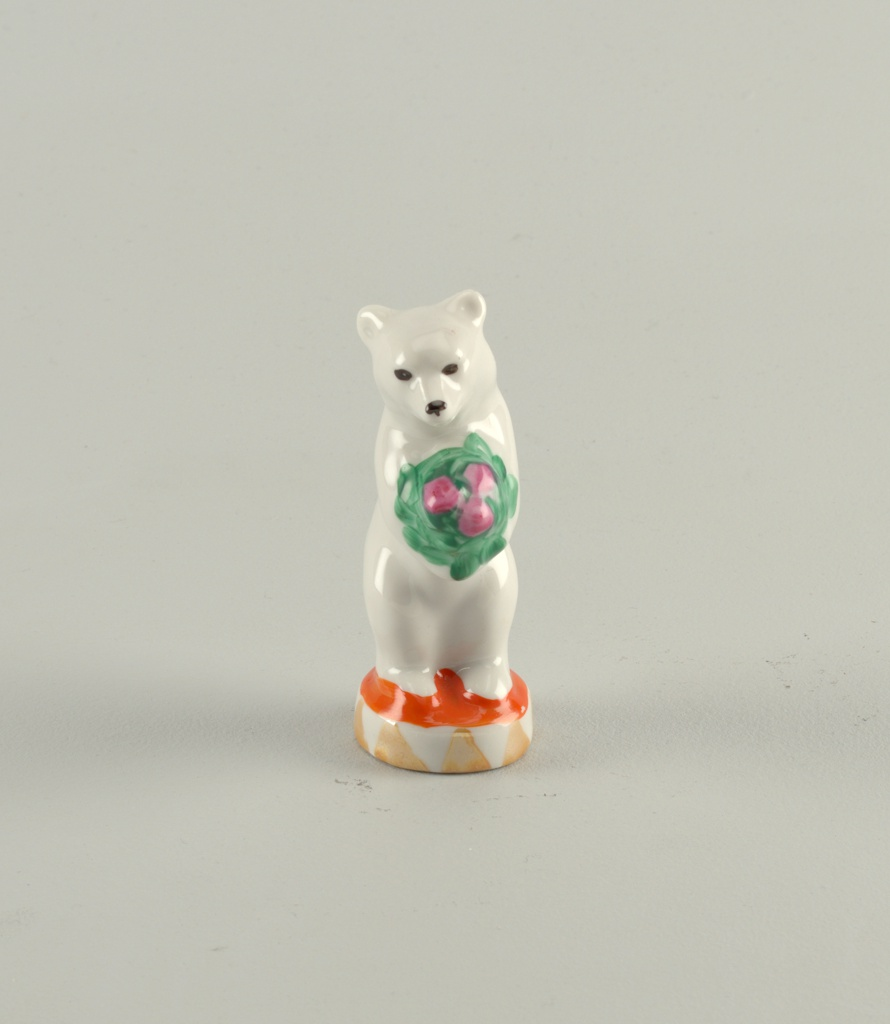 Post-revolutionary ceramic figure of a bear. The bear is a traditional symbol of Russia, especially when it appears as a circuz performer, as this one does.