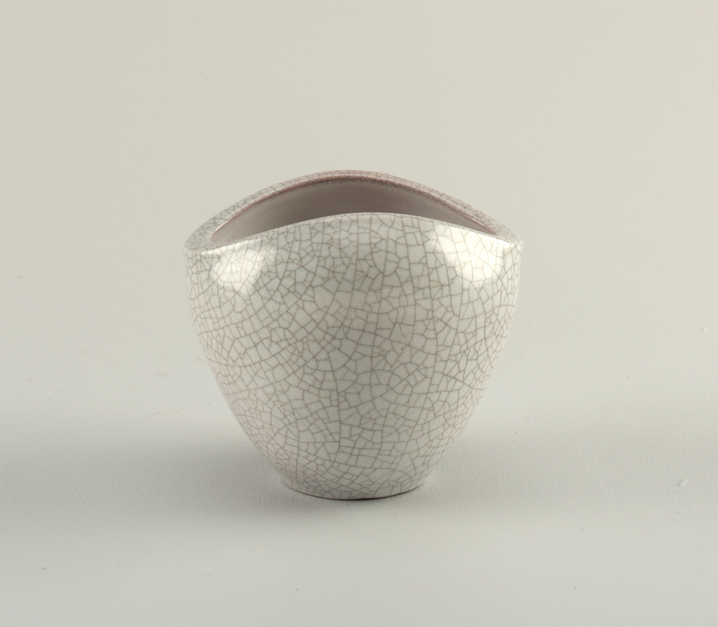Inverse conical vase with a flat base and large curved mouth. Crackle and grey body.