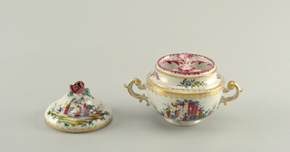 Two handled cup with two round openings at top. Decorated with scenes of ruins, flowers and gilding. Cover decorated with scenes of ruins and a floral finial.